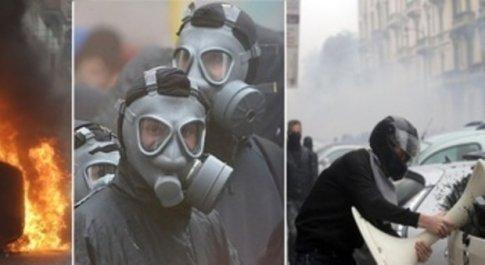 Guerriglia a Milano: i No Expo devastano il centro, molotov e auto in fiamme. 10 fermati, feriti 11 membri delle forze dell'ordine