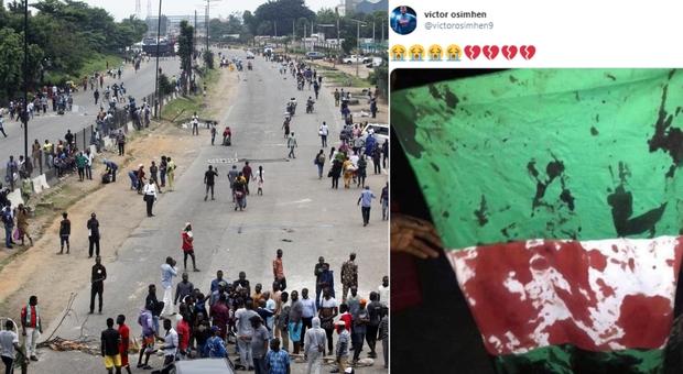 Nigeria, «manifestanti contro il coprifuoco uccisi dalla polizia». Osimhen mostra una bandiera insanguinata