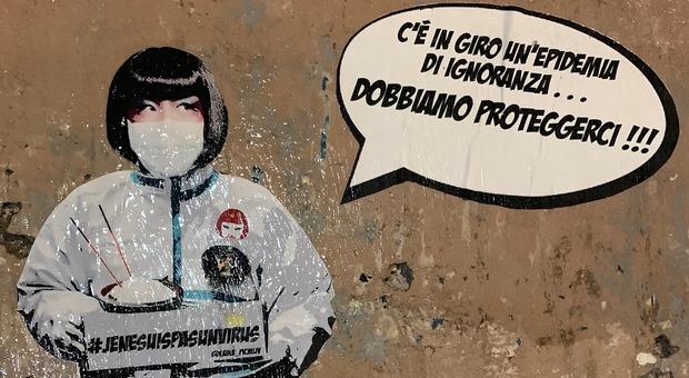 Coronavirus, a Roma spunta il murale con la ristoratrice cinese Sonia in tuta bianca: «Dobbiamo proteggerci»