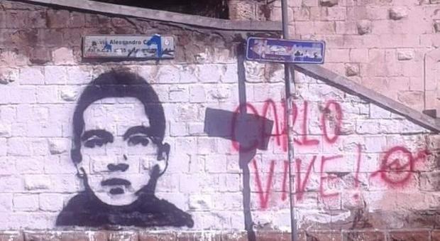 Roma, ridipinto il murale dedicato a Carlo Giuliani alla Garbatella