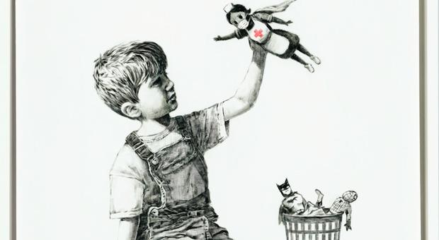 """Banksy, all'asta da Christie's """"Game Changer"""", l'opera simbolo della pandemia: il ricavato al servizio sanitario inglese"""